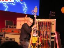 Adam fixes the Ping Pong ball machine gun.